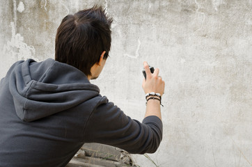 Graffiti artist holding spray can