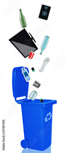 Closeup of blue recycle bin with recyclable materials