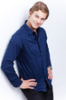 Portrait of a young handsome man wearing blue shirt isolated on