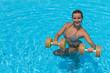 Woman is engaged aqua aerobics in water