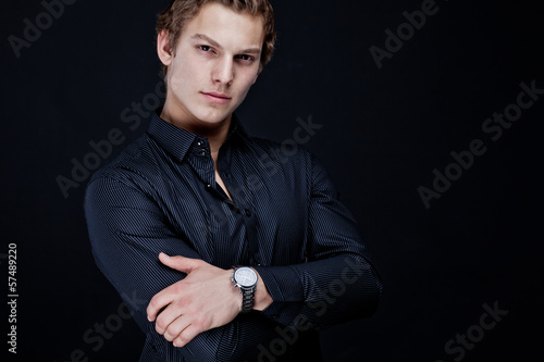 portrait of sexy macho man over dark background