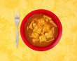 Ravioli meal in a bowl with a fork to the side
