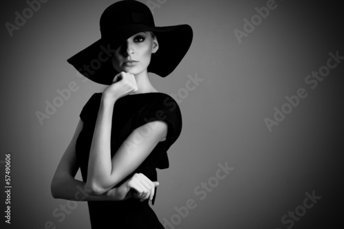 high fashion portrait of elegant woman in black and white hat an