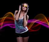 Fototapety young DJ woman enjoying the music in the headphones