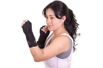 Female mixed martial arts fighter wearing MMA style gloves