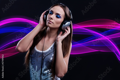woman DJ enjoying the music in the headphones