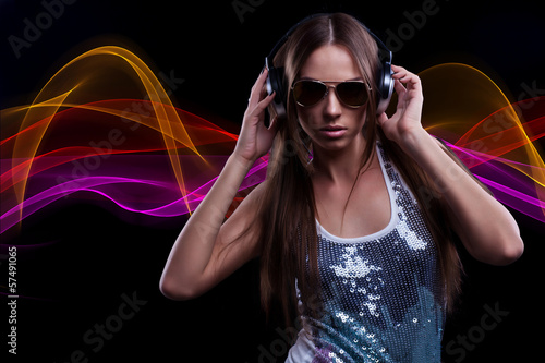 young DJ woman enjoying the music in the headphones