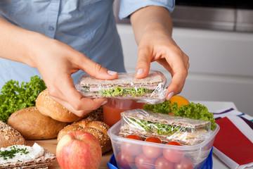 Woman preparing takeaway meal