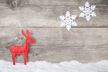 Christmas Reindeer on wooden background