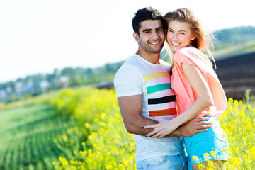 Romantic young couple in a field