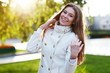 Young woman outdoors portrait. Soft sunny colors