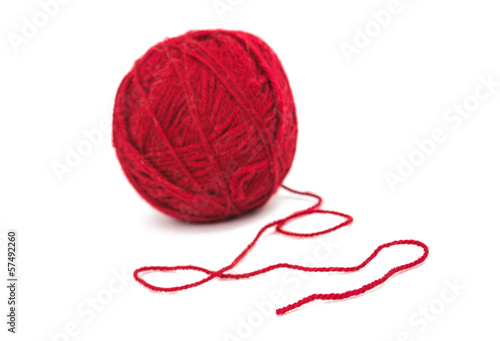 tangle of red thread isolated - 57492260