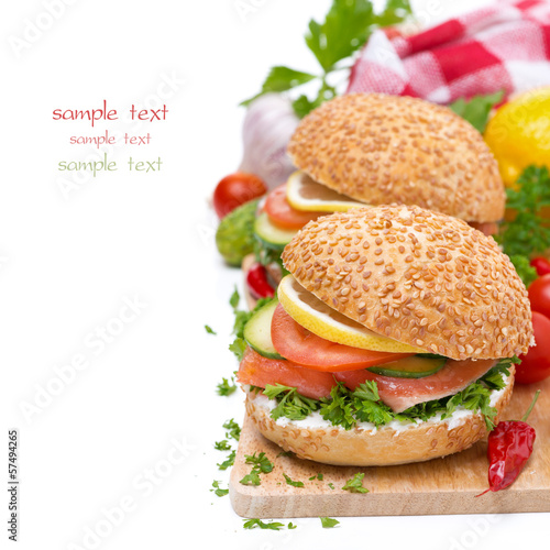 delicious burgers with smoked salmon and vegetables on board