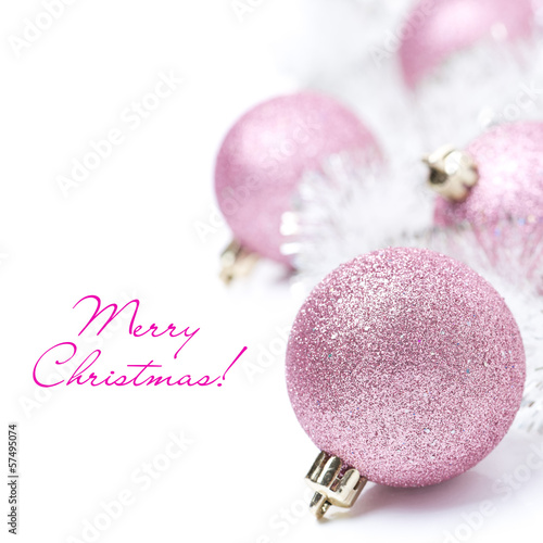 composition with pink Christmas balls and tinsel, isolated