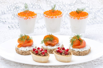holiday appetizers - canape with salmon, tartlet with liver pate