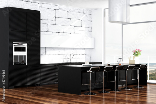 Contemporary black design kitchen in front of white stone wall