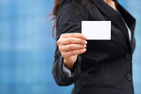 Businesswoman showing business card