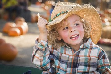 Little Boy in Cowboy Hat at Pumpkin Patch