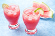 Two glasses of watermelon cocktail with brown sugar and lime