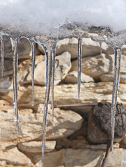 icicles on stone wall