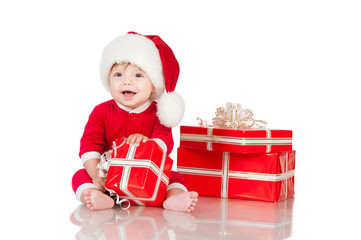 Cheerful little Santa Claus with presents. Isolated on white bac