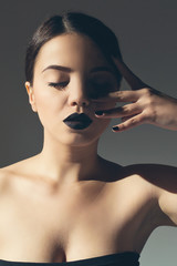 Fashionable attractive woman with black lipstick