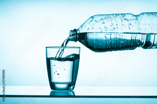 bottled water and a glass