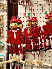 Souvenirs Pinocchio marionettes and magnets from Rome