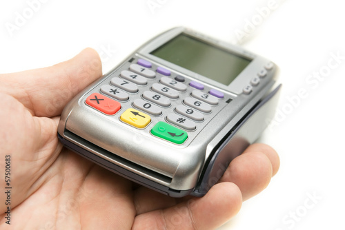 The modern bank terminal in a man's hand