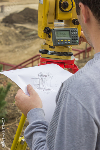 Land surveyor analyzing a cadastral and site plans
