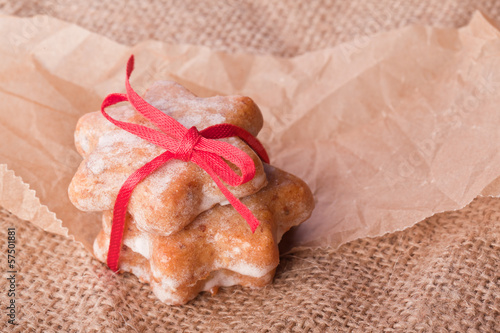 cinnamon christmas star cookies with red ribbon