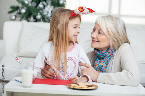 Grandmother And Girl With Cardpaper Looking At Each Other