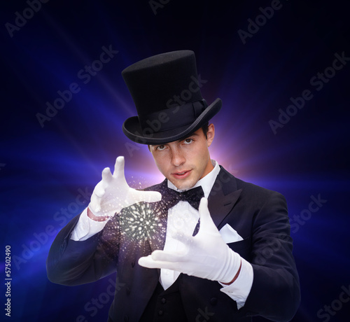 magician in top hat showing trick