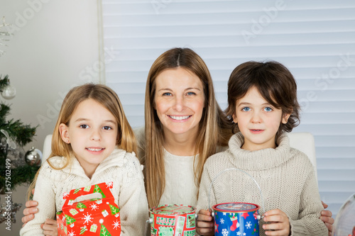 Happy Mother And Children With Christmas Gifts