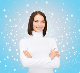 smiling woman in white sweater