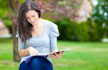 Young student reading in the park