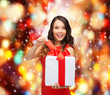 smiling woman in red dress with gift box