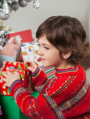 Boy Stacking Christmas Gifts