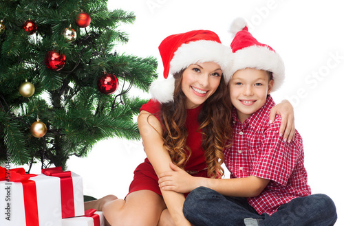 happy mother and child boy with gift boxes