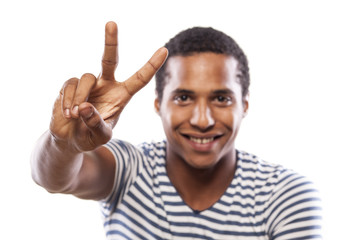 smiling dark-skinned young man showing two fingers up