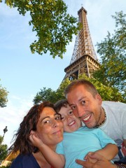 happy family in Paris holidays Eiffel tower