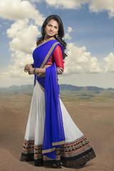 Pretty Indian girl in traditional Indian half sari.