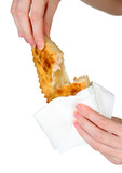 Hand holding tasty cheburek, isolated on white