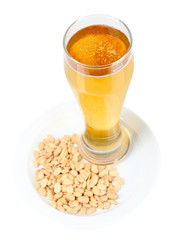 Beer in glass and nuts isolated on white