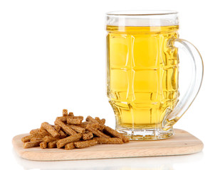 Beer in glass and croutons on on board isolated on white