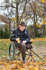 Senior handicapped man in a wheelchair