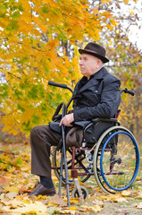 Handicapped senior enjoying the autumn sun