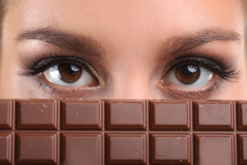 Portrait of beautiful young girl with chocolate closeup