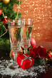 Composition with Christmas decorations and two champagne