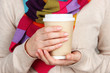Hot drink in paper cup in hands close up